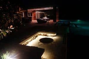 Outdoor LED bench lighting beside the pool.